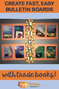 Create a light science bulletin board with trade books.